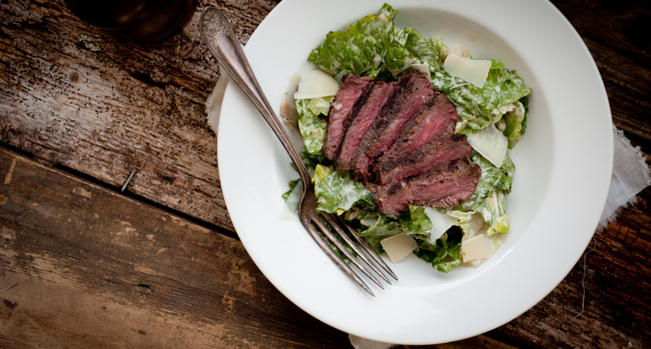 grilled strip steak and caesar salad